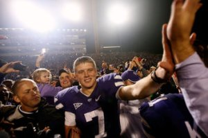 Collin Klein and jubilant teammates celebrate the program's third conference championship in 117 years of football. (Photo by Jamie Squire)